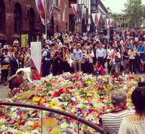 people mourn the victims of sydney attack
