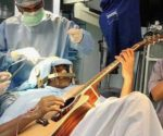 man-plays-guitar-during-brain-surgery